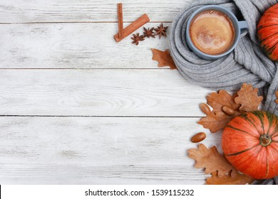 Grey mug of coffee wrapped in plaid or scarf, spices, dry oak leaves, acorns, orange pumpkins on white wooden table. Autumn drink concept. Fall, pumpkin spicy latte, thanksgiving, top, copy space - Shutterstock ID 1539115232