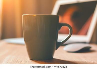 Grey mug on the wooden table
