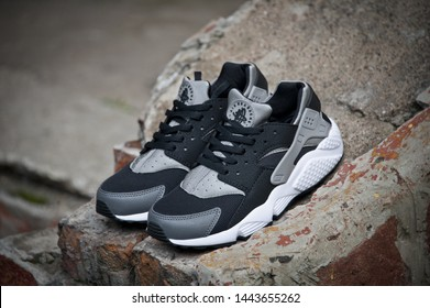 Grey Nike Air Huarache sport shoes shot outdoors on colorful background. Nike sneakers, trainers close up view. Sport and casual footwear concept. Krasnoyarsk, Russia - August 11, 2015