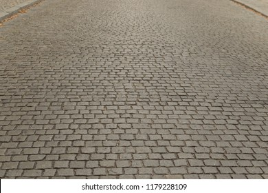 Grey Old Pavement Top View or Granite Cobblestone Road. Ancient Brick Cobblestoned Floor or Granite Tiles Street with Big Stones