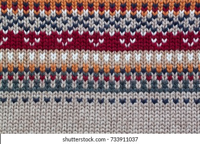 Grey, orange, bordo and beige realistic knitting pattern. Jacquard technic
