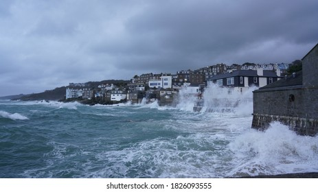 Grey overcast skies, stormy seas on wet autumn day in St Ives Cornwall October 2020