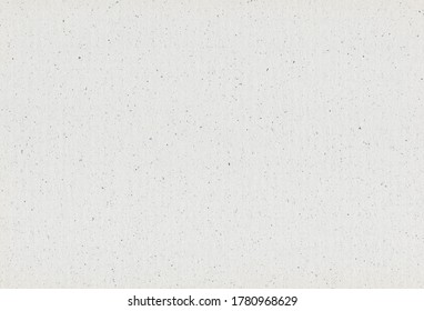 Grey paper recycled background with inclusions of paper particles. Extra large highly detailed image. Recycled paper concept.