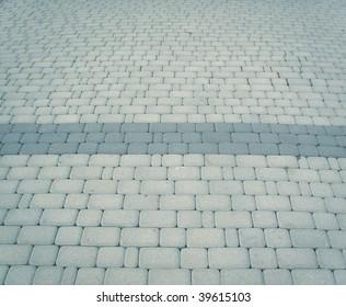 grey pavement with dark stripe