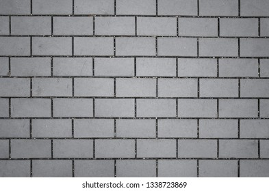 Grey paving stones as background.  Grey granite cobblestone. Close-up. Top view.
