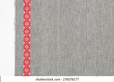 grey place mat with red stripe on white background