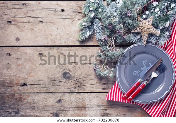 Grey  plate, knife, fork  and napkin  on rustic wooden background. Top view. Place for text. Selective focus