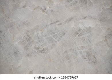 Grey quartzite stone with natural pattern texture background.