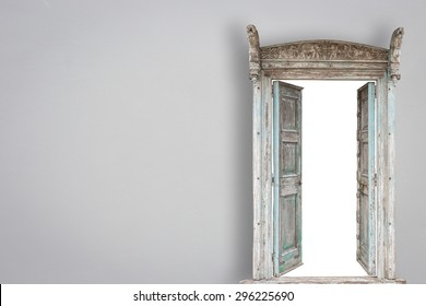 Grey retro style wooden door on gery cement wall background
