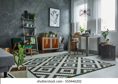 Grey room with window, carpet, dresser and table