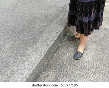 grey shoes on asian female legs standing on the floor., copy space