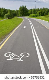 grey sinuous bicycle path in the park
