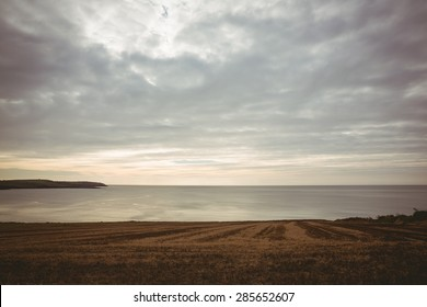 Grey sky over expansive ocean beautiful scene shot