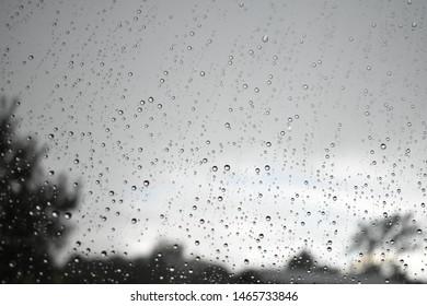 grey sky and rain against a blurred window