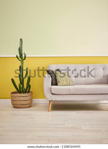 Magnificent Grey Sofa Furniture Turquoise Yellow Wall Stock Photo Edit Pdpeps Interior Chair Design Pdpepsorg