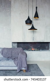 grey sofa near fireplace in loft room