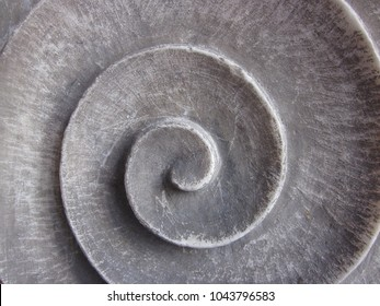 grey spiral made of stone, detail of a house in Genova