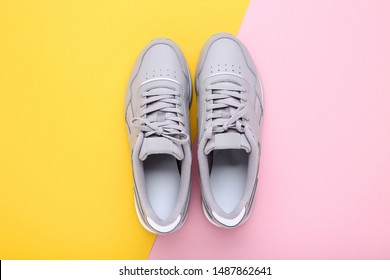 Grey sport shoes on colorful background