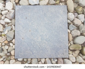 grey square tile and stones and rocks