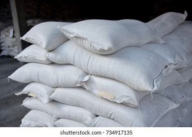 Grey stacked sacks of flour at the farmers ' warehouse