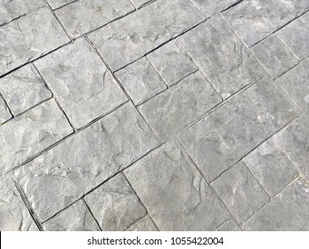 Grey stamped concrete background for texture design