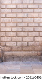 Grey stone bricks in monumental facade