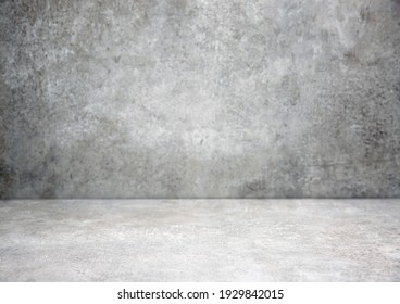 Grey stone grungy stage,empty room background,free space interior.Cement wall.Advertisement design studio.Modern backdrop. - Shutterstock ID 1929842015