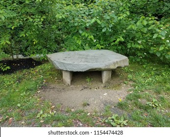 grey stone or rock bench or seat or table