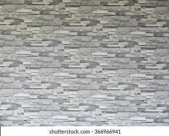 Grey stone tile wall pattern.