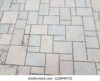 grey stone tiles on the ground or tessellation or background