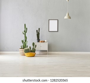 Grey stone wall background, grey interior room, Modern home, old book, grey cabinet style with wicker vase of cactus, frame and white lamp decor. Home objects in the room and parquet detail.