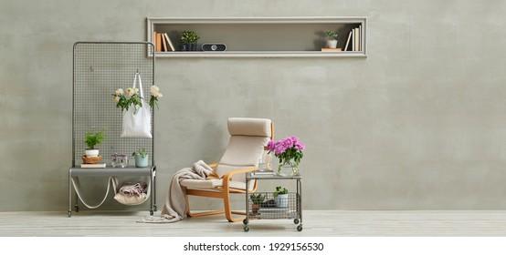 Grey stone wall background,niche, rocking chair, flower detail, home decoration style.