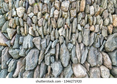 Grey stones wall for background. ireland.