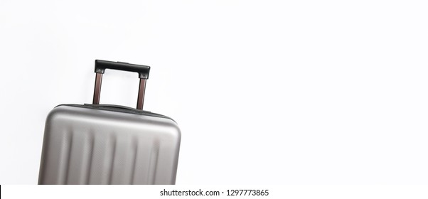 Grey suitcase on light background with place for text. Minimal creative travel concept