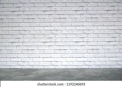 Grey table top with white brick wall background. Mock up for display or montage. Can be use for banner, advertising, Free space for any text or product.