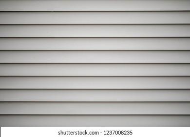 Grey or tan vinyl siding on a building