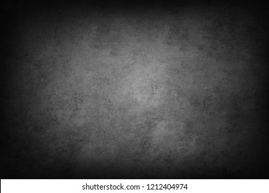 Grey textured background. Dark edges