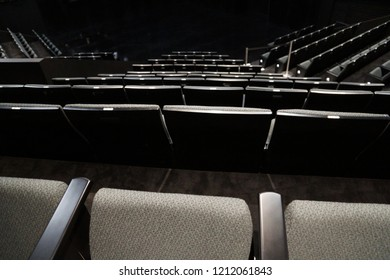 Grey theatre seating looking downstairs