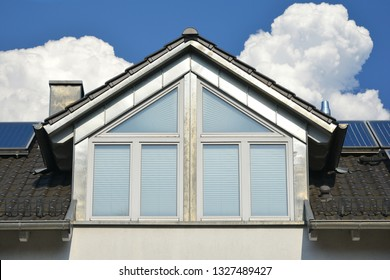 Grey tiled Roof with Metal faced saddleback Dormer Window Chimney with Rain Gutter and Snow Fence