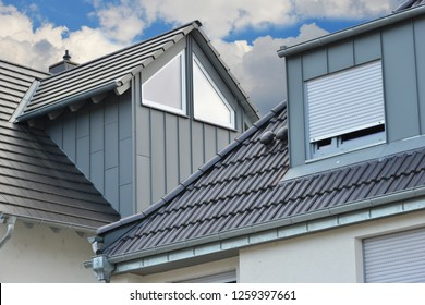Grey Tiled Roof and standing Seam Metal plated Fume Hoods, Eves Gutter, Rain Pipe and Metal plated Chimneys