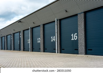 Grey unit storage warehouse facility with numbered doord