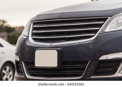 Grey Vehicle Car Hood Vent and Blank License Plate Close Up with Desert Background