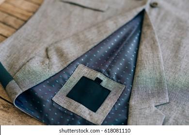 Grey vest lying on the table. Wedding Groom Wear.