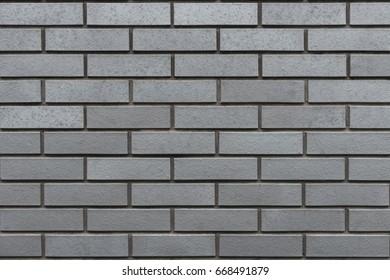 Grey wall with clinker bricks. Brick, Wall, Background.