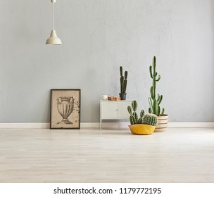 Grey wall interior room vase of plant and parquet detail with frame.