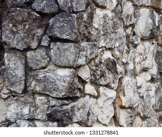 A Grey Weathered Stone Wall