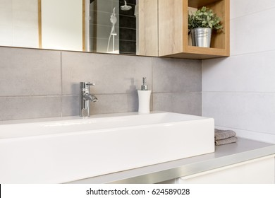 Grey and white bathroom with countertop basin and mirror
