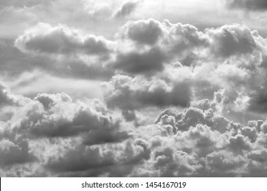 Grey and white cloud abstract background. Sad, dead, hopeless, and despair background. Thunder and storm concept. Grey sky and fluffy clouds. Unlucky day concept. Sad and moody sky. Nature background.