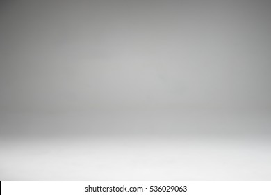 Grey and white gradient in studio wall for copyspace background