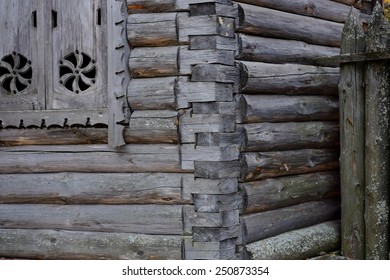 Grey wooden wall of an izba